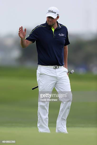 Marc Leishman of Australia acknowledges the gallery on the 4th green during the second round of the Farmers Insurance Open on Torrey Pines South on...
