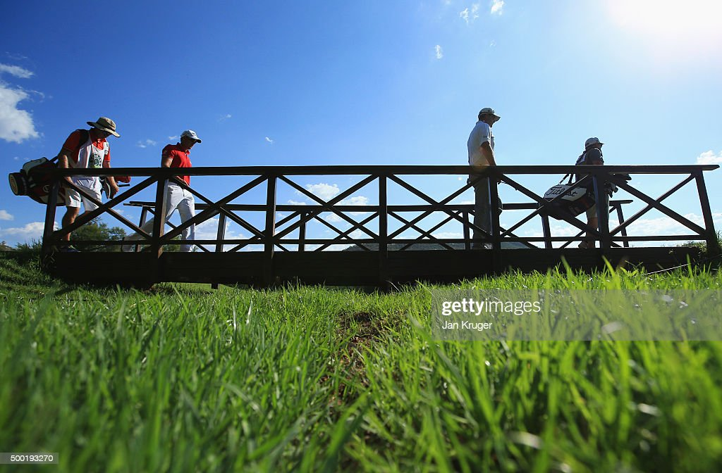 Marc Leishman of Australia and Henrik Stenson of Sweden walk over a bridge during the final round on day four of the Nedbank Golf Challenge at Gary Player CC on December 6, 2015 in Sun City, South Africa.