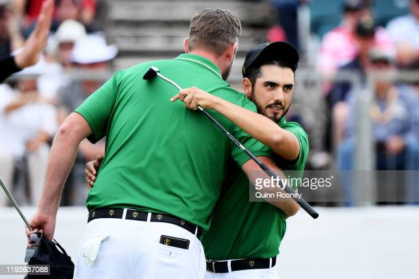 Marc Leishman of Australia and the International team and Abraham Ancer of Mexico and the International team celebrate their 32 win over Webb Simpson...