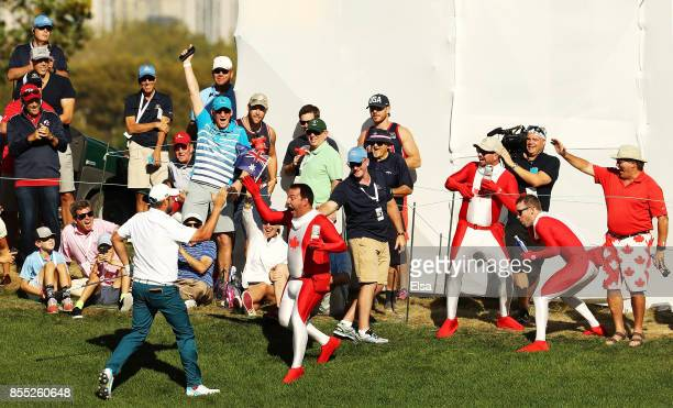 Marc Leishman of Australia and the International Team celebrates after chipping in on the ninth green during Thursday foursome matches of the...