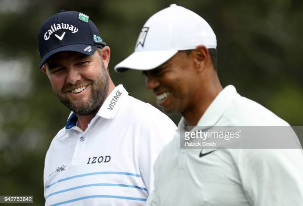 Marc Leishman of Australia and Tiger Woods of the United States walk off the eighth tee during the second round of the 2018 Masters Tournament at...
