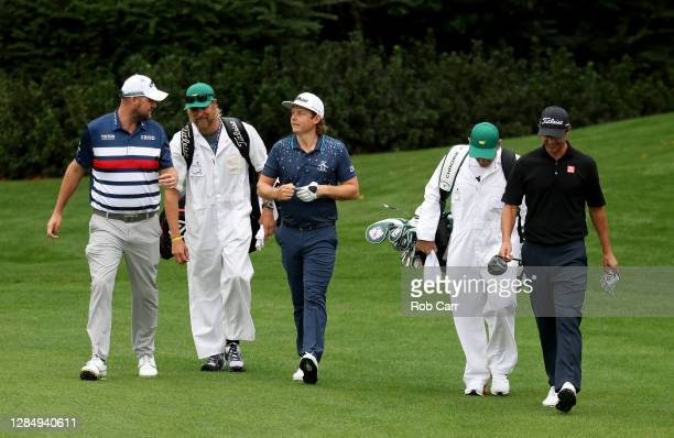 Marc Leishman of Australia Cameron Smith of Australia and Adam Scott of Australia walk on the 14th hole during a practice round prior to the Masters...