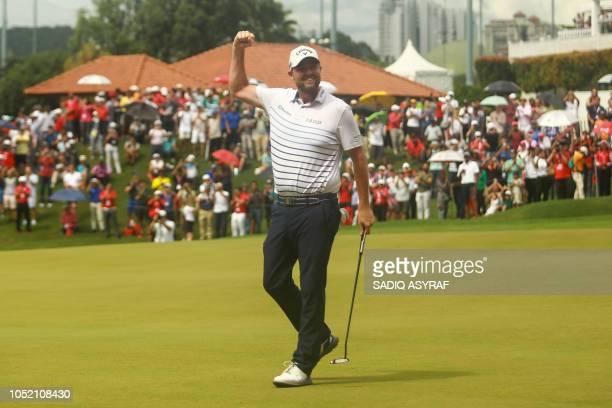 Marc Leishman of Australia celebrates after winning the 2018 CIMB Classic golf tournament in Kuala Lumpur on October 14 2018