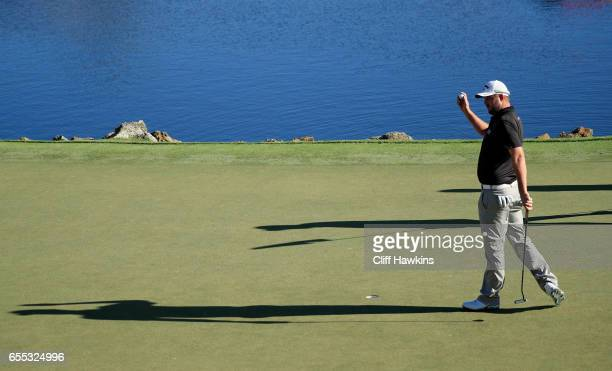 Marc Leishman of Australia celebrates on the 18th green after finishing 11 under to win during the final round of the Arnold Palmer Invitational...