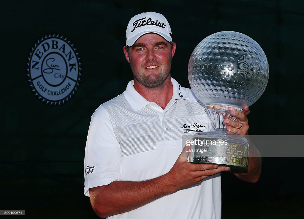 Marc Leishman of Australia celebrates victory with the trophy after the final round on day four of the Nedbank Golf Challenge at Gary Player CC on December 6, 2015 in Sun City, South Africa.