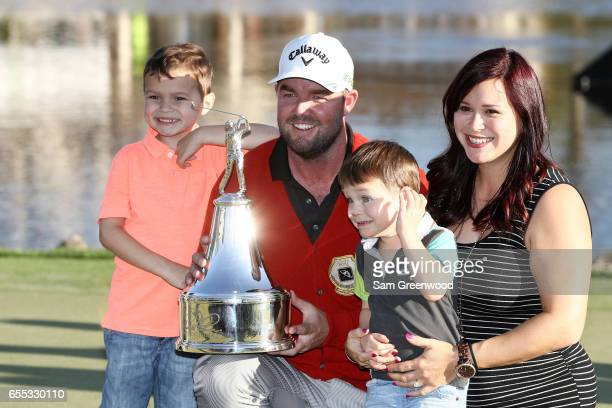 Marc Leishman of Australia celebrates with wife Audrey and children Oliver and Harry after finishing on the 18th green during the final round of the...