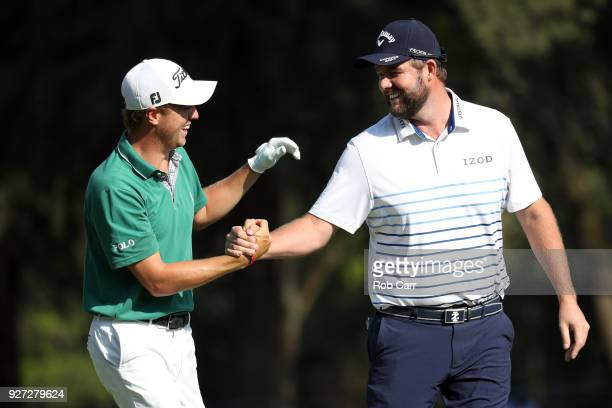 Marc Leishman of Australia congratulates Justin Thomas after he did an eagle from the 18th fairway during the final round of World Golf...