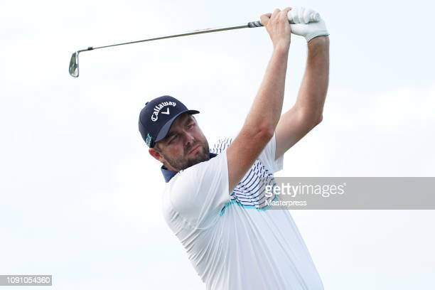 Marc Leishman of Australia hits a tee shot on the 13th green during the final round of the Sentry Tournament of Champions at the Plantation Course at...