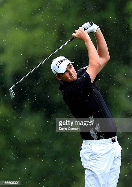 Marc Leishman of Australia hits his second shot on the fifth hole during the final round of the 2013 Masters Tournament at Augusta National Golf Club...