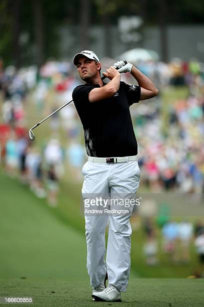 Marc Leishman of Australia hits his second shot on the first hole during the final round of the 2013 Masters Tournament at Augusta National Golf Club...