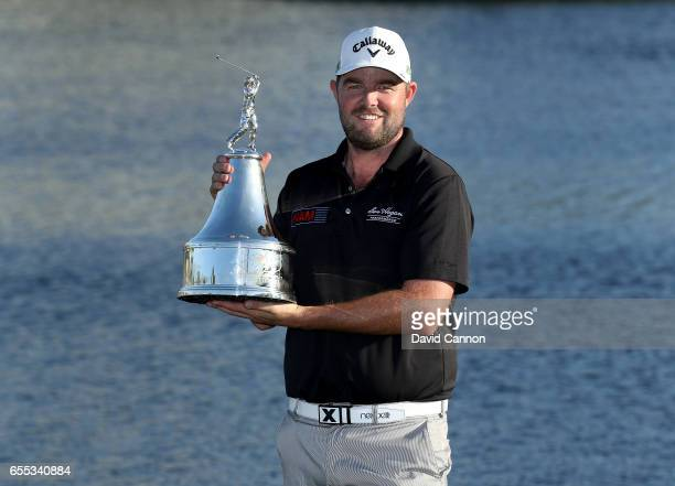 Marc Leishman of Australia holds the trophy after his one shot victory in the final round of the 2017 Arnold Palmer Invitational presented by...