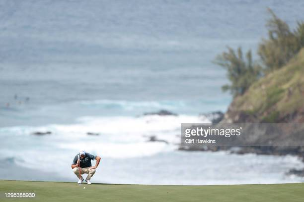 Marc Leishman of Australia lines up a putt on the 11th green during the second round of the Sentry Tournament Of Champions at the Kapalua Plantation...