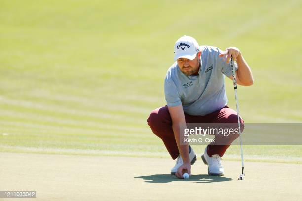 Marc Leishman of Australia lines up a putt on the second green during the third round of the Arnold Palmer Invitational Presented by MasterCard at...