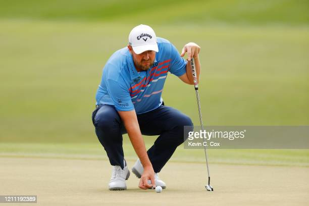 Marc Leishman of Australia lines up a putt on the second green during the final round of the Arnold Palmer Invitational Presented by MasterCard at...