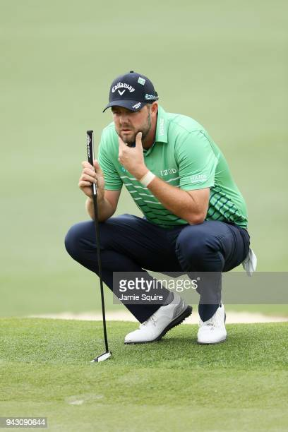 Marc Leishman of Australia lines up a putt on the second green during the third round of the 2018 Masters Tournament at Augusta National Golf Club on...