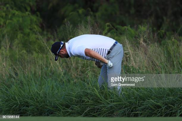 Marc Leishman of Australia locates his ball on the fourth hole during the third round of the Sentry Tournament of Champions at Plantation Course at...