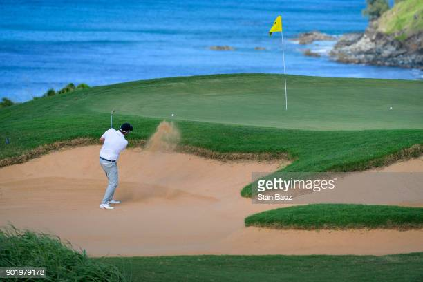 Marc Leishman of Australia plays a bunker shot on the 11th hole during the third round of the Sentry Tournament of Champions at Plantation Course at...
