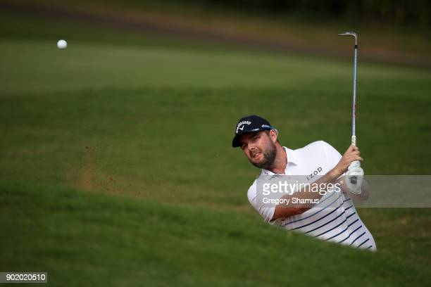 Marc Leishman of Australia plays a shot from a bunker on the 14th hole during the third round of the Sentry Tournament of Champions at Plantation...