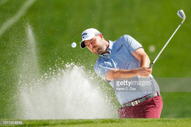 Marc Leishman of Australia plays a shot from a bunker on the seventh hole during the third round of the Arnold Palmer Invitational Presented by...