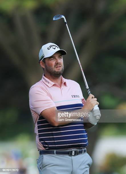 Marc Leishman of Australia plays a shot on the 15th hole during round one of the Sony Open In Hawaii at Waialae Country Club on January 11 2018 in...