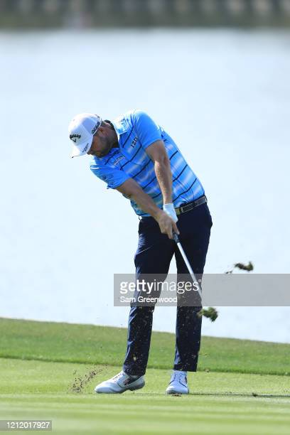 Marc Leishman of Australia plays a shot on the 18th hole during the first round of The PLAYERS Championship on The Stadium Course at TPC Sawgrass on...