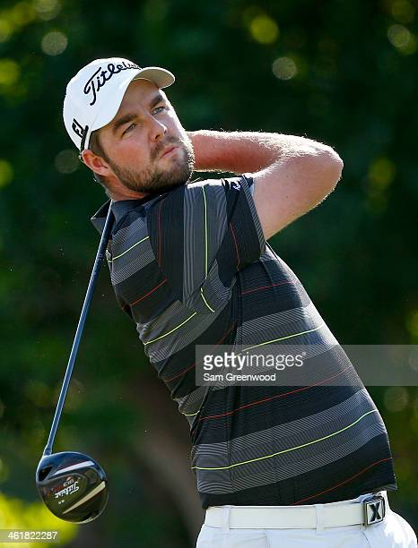 Marc Leishman of Australia plays a shot on the 1st hole during the third round of the Sony Open in Hawaii at Waialae Country Club on January 11 2014...