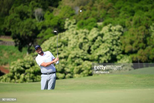 Marc Leishman of Australia plays a shot on the ninth hole during the third round of the Sentry Tournament of Champions at Plantation Course at...