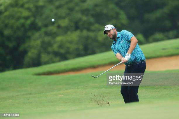 Marc Leishman of Australia plays a shot on the ninth hole during the final round of the Sentry Tournament of Champions at Plantation Course at...