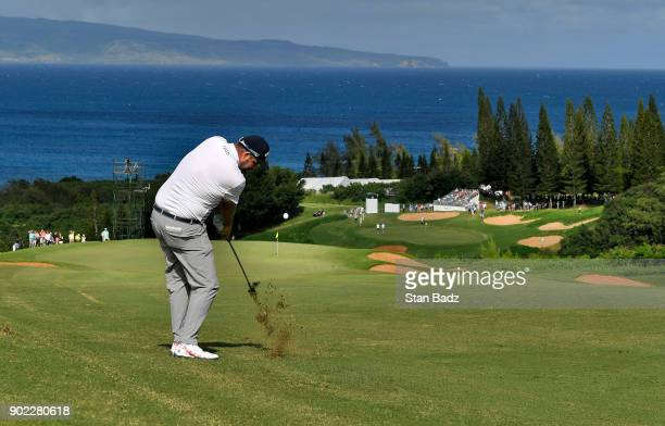 Marc Leishman of Australia plays a shot on the seventh hole during the third round of the Sentry Tournament of Champions at Plantation Course at...