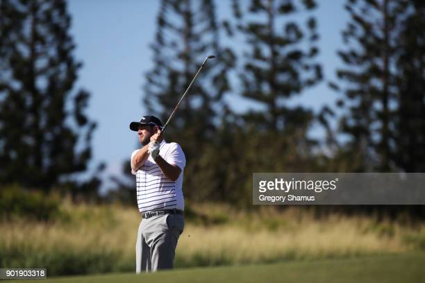 Marc Leishman of Australia plays a shot on the third hole during the third round of the Sentry Tournament of Champions at Plantation Course at...