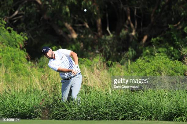 Marc Leishman of Australia plays his second shot on the fourth hole during the third round of the Sentry Tournament of Champions at Plantation Course...