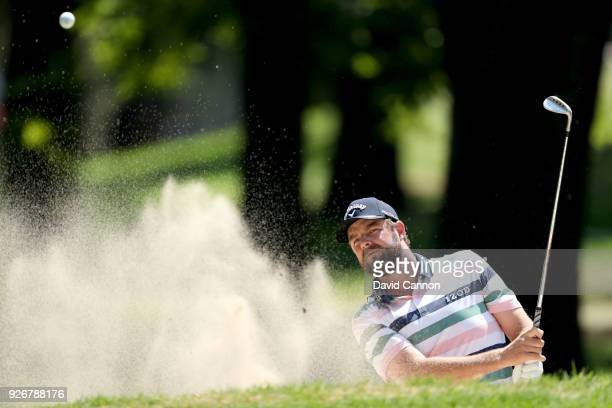 Marc Leishman of Australia plays his second shot on the par 3 third hole during the third round of the World Golf ChampionshipsMexico Championship at...