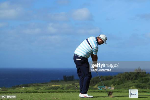 Marc Leishman of Australia plays his shot from the 11th tee during the second round of the Sentry Tournament of Champions at Plantation Course at...