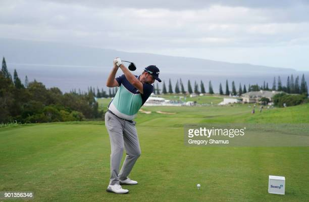 Marc Leishman of Australia plays his shot from the 18th tee during the first round of the Sentry Tournament of Champions at Plantation Course at...
