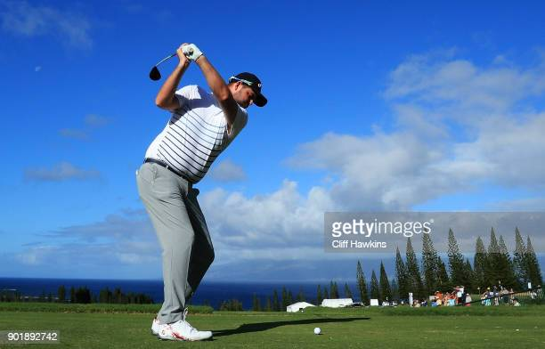 Marc Leishman of Australia plays his shot from the first tee during the third round of the Sentry Tournament of Champions at Plantation Course at...