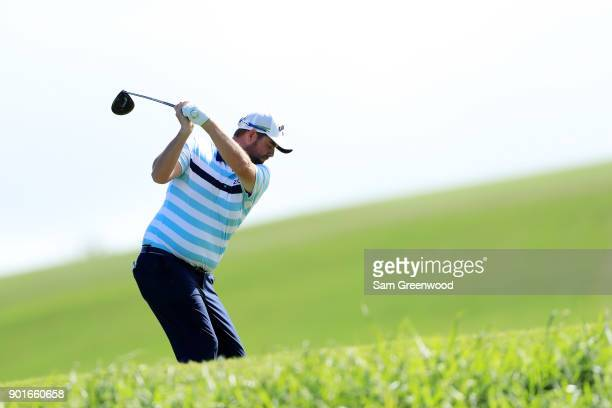 Marc Leishman of Australia plays his shot from the fourth tee during the second round of the Sentry Tournament of Champions at Plantation Course at...