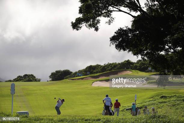 Marc Leishman of Australia plays his shot from the fourth tee during the third round of the Sentry Tournament of Champions at Plantation Course at...