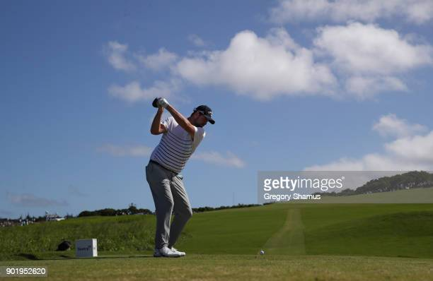 Marc Leishman of Australia plays his shot from the tenth tee during the third round of the Sentry Tournament of Champions at Plantation Course at...