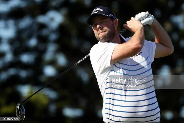 Marc Leishman of Australia plays his shot from the third tee during the third round of the Sentry Tournament of Champions at Plantation Course at...