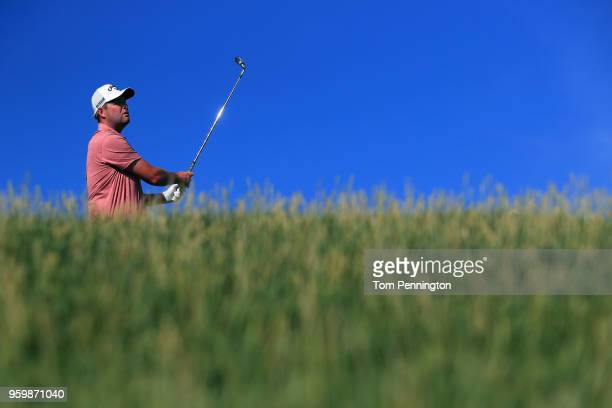 Marc Leishman of Australia plays his tee shot on the 12th hole during the second round of the ATT Byron Nelson at Trinity Forest Golf Club on May 18...