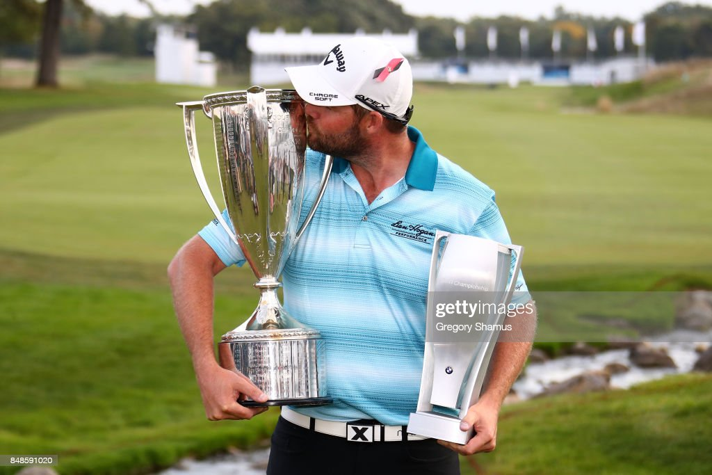 Marc Leishman of Australia poses with the Wadley Cup and the BMW Championship Trophy after winning the BMW Championship at Conway Farms Golf Club on September 17, 2017 in Lake Forest, Illinois.