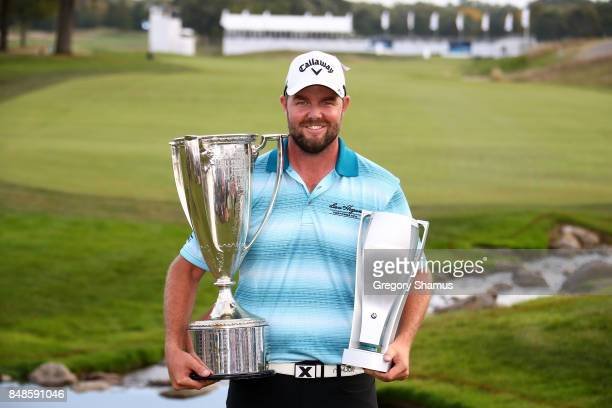 Marc Leishman of Australia poses with the Wadley Cup and the BMW Championship Trophy after winning the BMW Championship at Conway Farms Golf Club on...