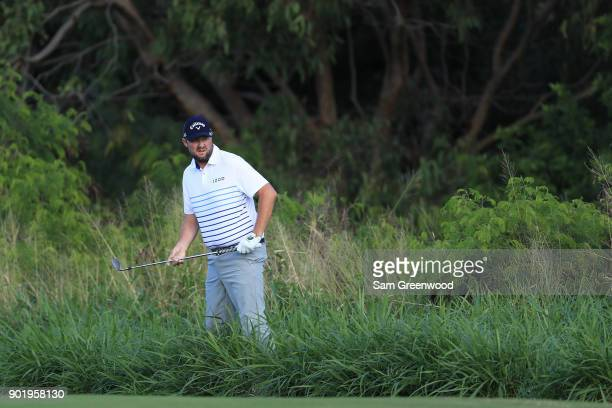 Marc Leishman of Australia prepares to play his second shot on the fourth hole during the third round of the Sentry Tournament of Champions at...