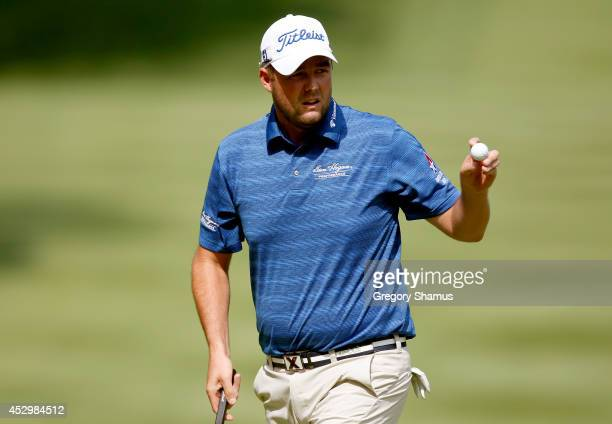 Marc Leishman of Australia reacts after a putt on the sixth green during the first round of the World Golf ChampionshipsBridgestone Invitational at...