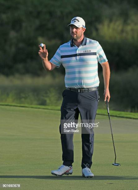 Marc Leishman of Australia reacts after finishing on the 18th green during the second round of the Sentry Tournament of Champions at Plantation...