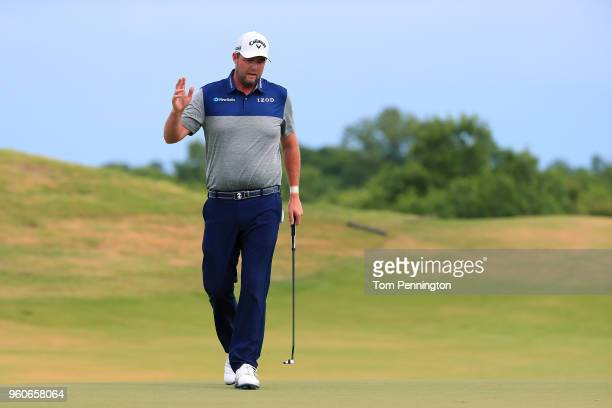 Marc Leishman of Australia reacts following an eagle putt on the fifth green during the final round of the ATT Byron Nelson at Trinity Forest Golf...