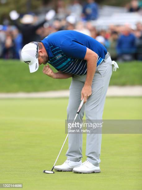 Marc Leishman of Australia reacts to his putt on the 18th green during the final round of the Farmers Insurance Open at Torrey Pines South on January...