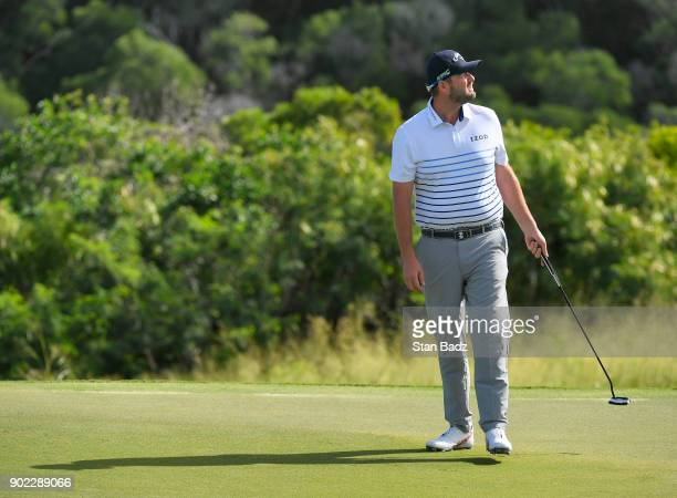 Marc Leishman of Australia reacts to his putt on the sixth hole during the third round of the Sentry Tournament of Champions at Plantation Course at...