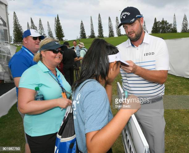 Marc Leishman of Australia signs autographs for fans after the third round of the Sentry Tournament of Champions at Plantation Course at Kapalua on...