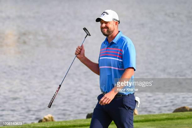 Marc Leishman of Australia smiles and waves his putter to fans on the 18th hole during the final round of the Arnold Palmer Invitational presented by...